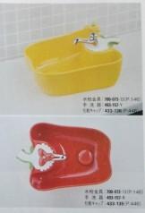 パプリカの洗面台 蛇口 赤と黄色